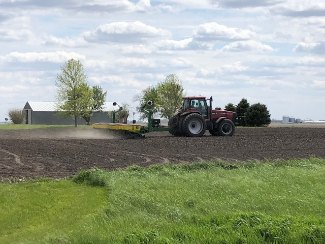 A farmer plants corn between Gridley and Meadows along Route 24 earlier this month / CIFN photo.