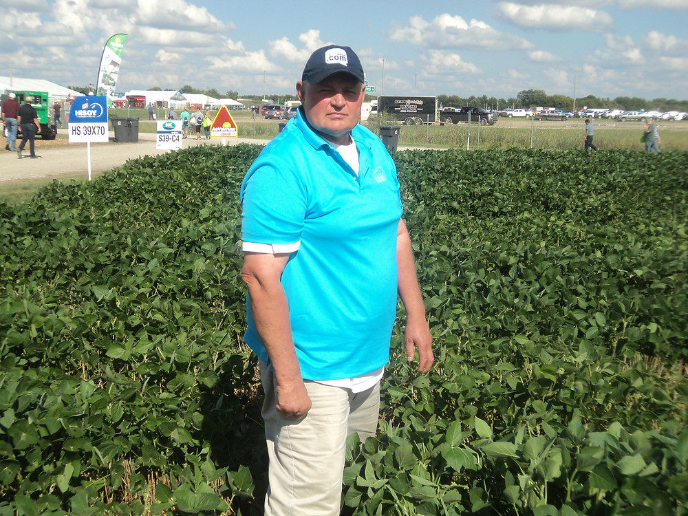ISA's Dan Davidson stands in a field of early planted double-crop soybeans at this year's Farm Progress Show at Decatur / CIFN photo.