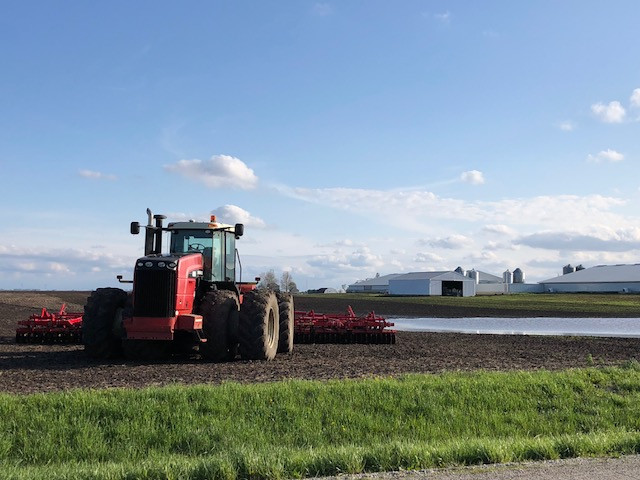 A tractor is parked in a muddy field near Anchor in McLean County on Friday / CIFN photo.