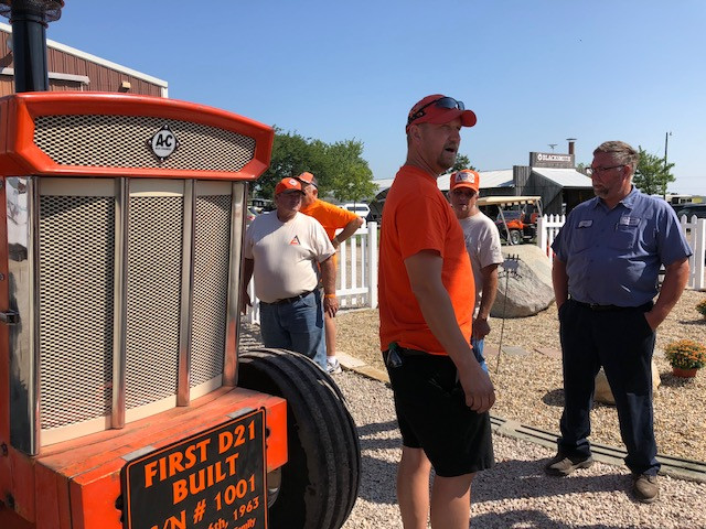 Darryl Krause shows the first ever D21 to a group of visitors at the Threshermen's Reunion in Pontiac Thursday morning /CIFN photo.