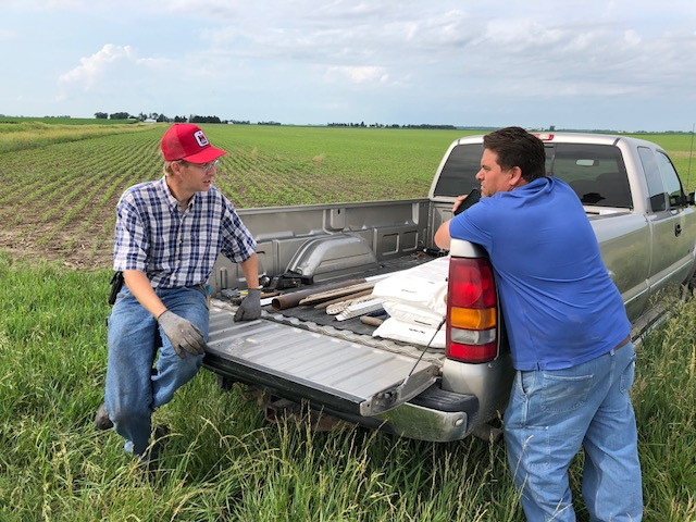 Local farmers John Wilken, left, and Tim McGreal chat near a field Friday morning / CIFN photo.