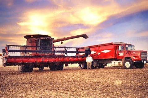 Rob Shaffer poses by his combine / photo courtesy of Rob Shaffer.