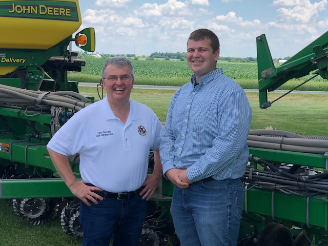 State Rep. Tom Bennett poses with his nephew, Alex at the Bennett farm near Gibson City last week / CIFN Photo.