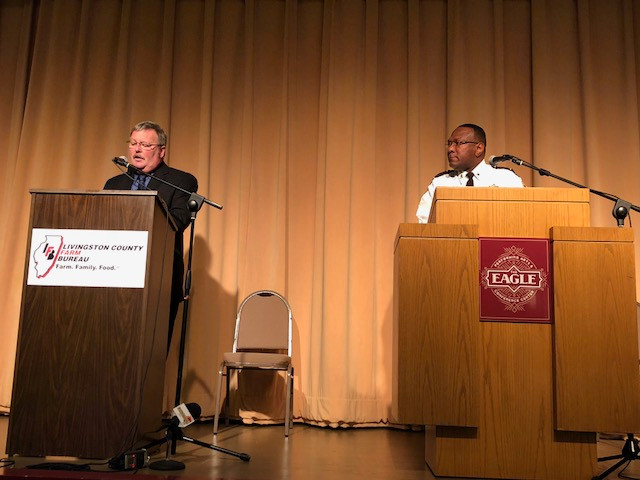 Candidates for Livingston County Sheriff speak in Pontiac Tuesday night / CIFN photo.