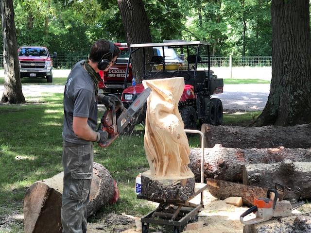 A wood carver at last week's Livingston County Ag Fair near Pontiac / CIFN photo.