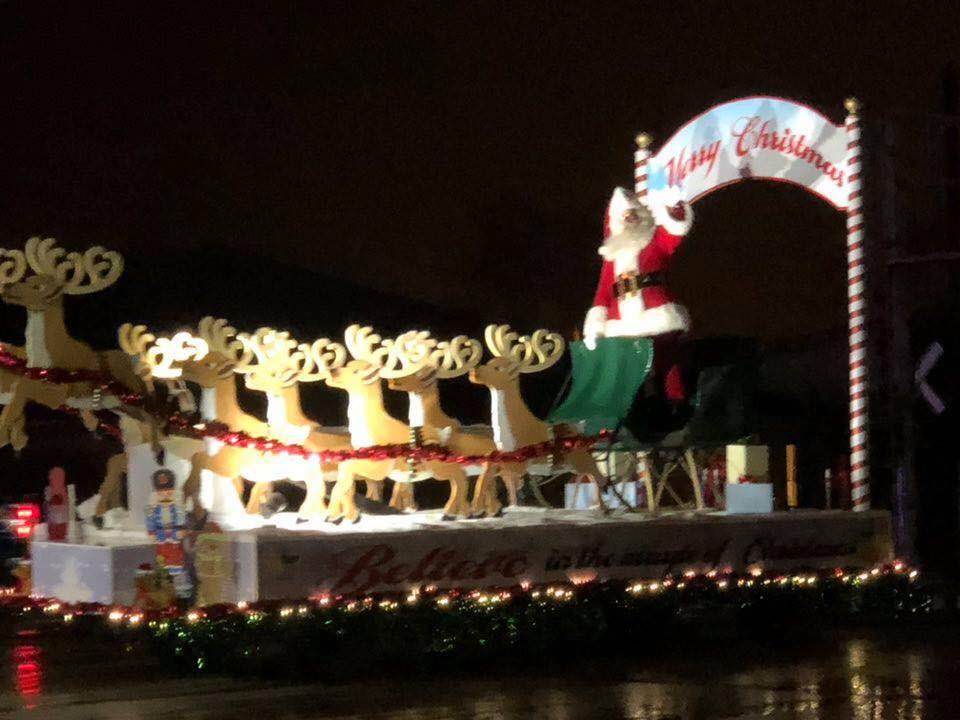 Santa waves to spectators in Gibson City Saturday evening / EOCI photo.