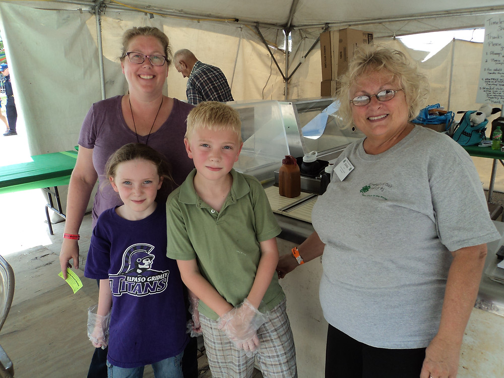 Volunteers scoop ice cream at the 4-H sundae booth at this year's McLean County Fair / CIFN photo.