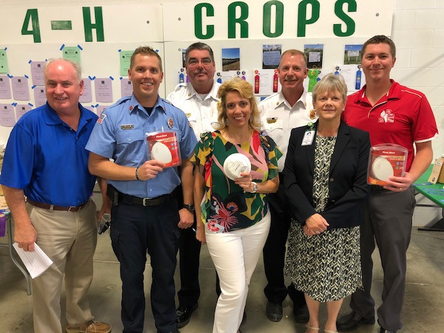 Local and state officials announce a new smoke detector law at this year's McLean County Fair in Bloomington / EOCI photo.