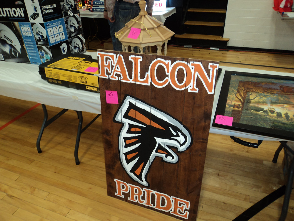 Auction items are shown Saturday evening at Flanagan-Cornell High School / CIFN photo