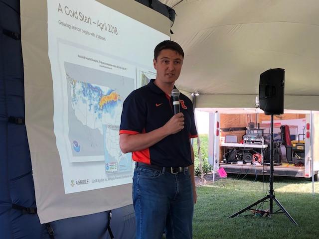 Eric Snodgrass speaks with farmers Wednesday near Lexington / CIFN photo.