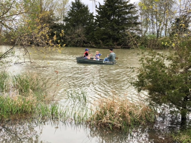 Kent and kids floating on the Casson pond recently / CIFN photo.