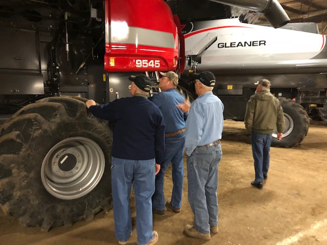 Farmers look at a combine displayed at Midwest Ag Expo Wednesday / CIFN photo.
