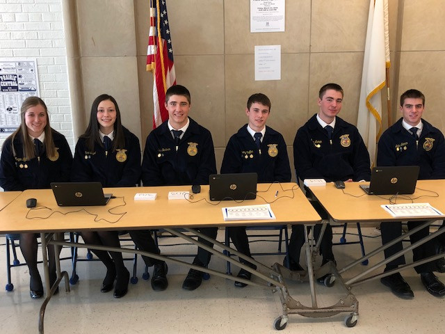 Officers for the Prairie Central High School FFA chapter pose Thursday night during the meal and auction in Fairbury / CIFN photo.