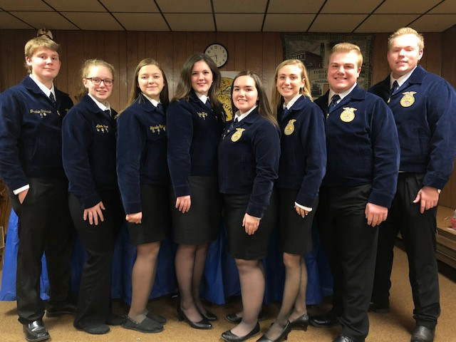 Tri-Point FFA officers are shown during the scholarship auction in Kempton Wednesday night / CIFN photo.