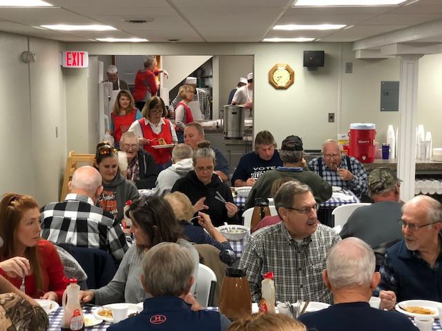 Visitors enjoy breakfast at the McDowell Stuffer on Thursday in Livingston County / CIFN photo.