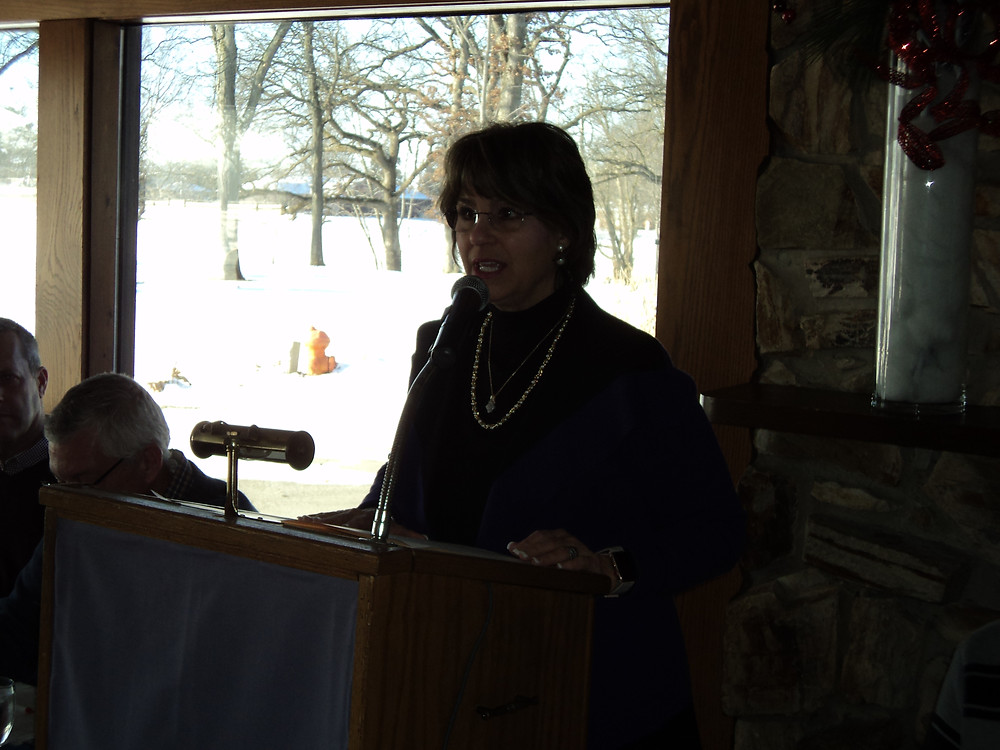 Cheryl Harvey of Enbridge speaks to those attending the annual meeting of the Livingston County Soil and Water Conservation District / EOCI photo.