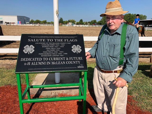 Carl Graf stands next to a newly-dedicated memorial at the McLean County Fair on Wednesday / CIFN photo.