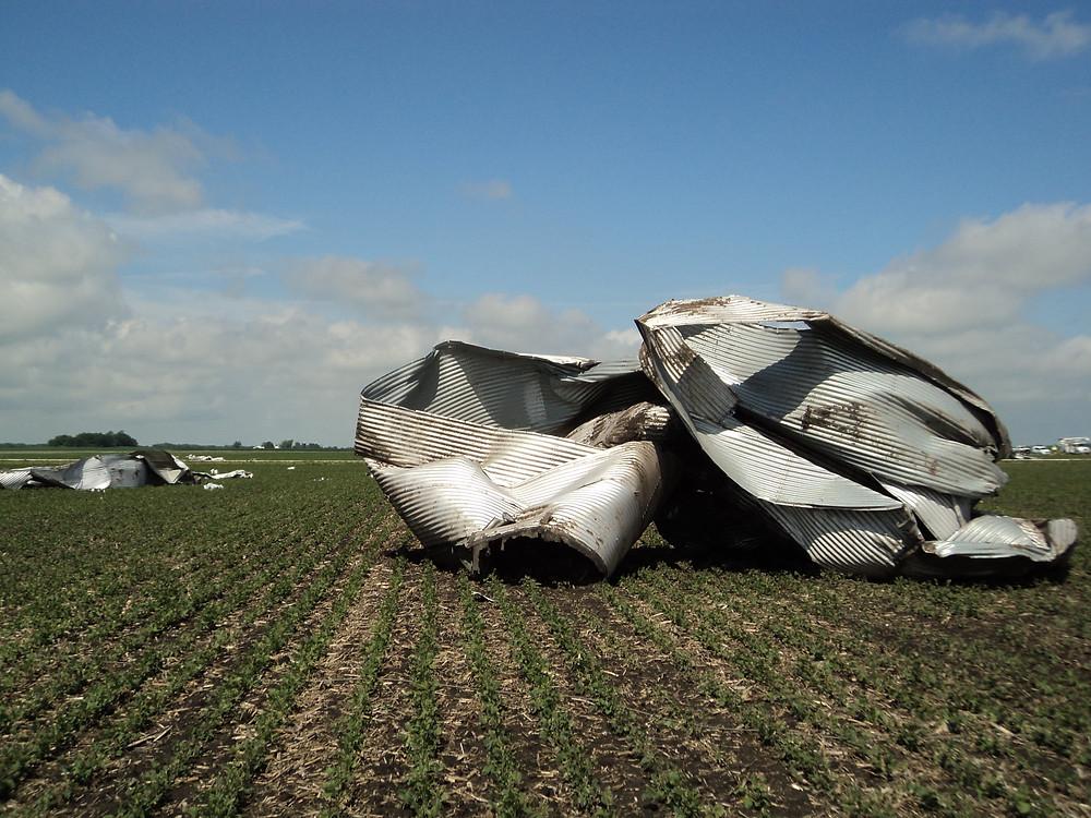 Bins were tossed around a field near Graymont last summer after a tornado struck / CIFN file photo.