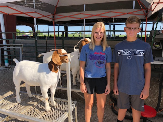 Cecilia and Carson Knott with their goats at the McLean County Fairgrounds this week / CIFN photo.
