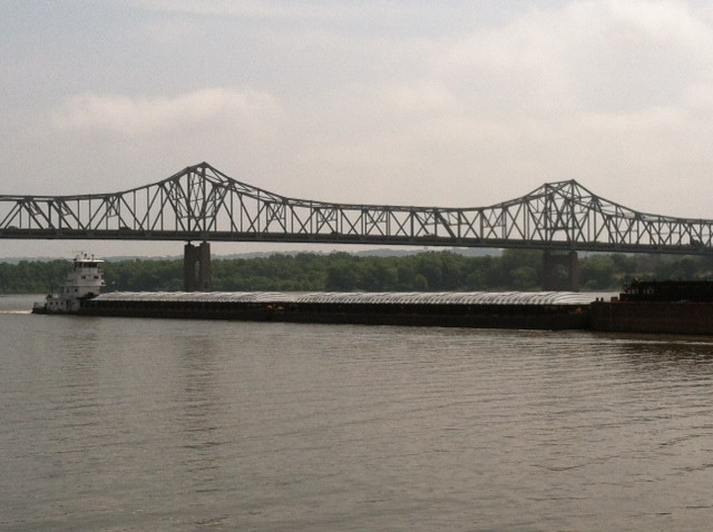 A barge is shown on the Illinois River at Peoria / CIFN file photo.