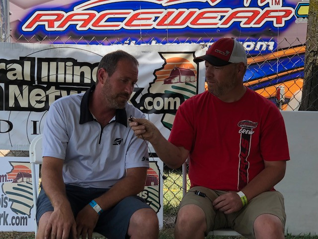 Mike Norris chats with Mike Harrison (left) about his racing and farming careers during a live remote on Saturday / CIFN photo.