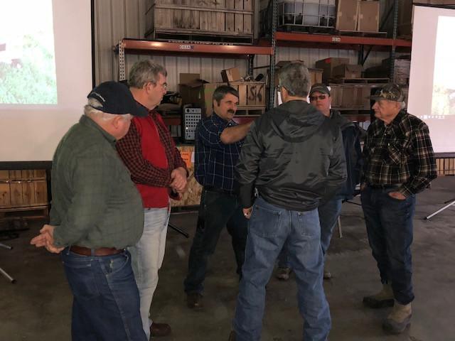 Ken Ferree (center) talks with farmers at a recent meeting / CIFN photo.