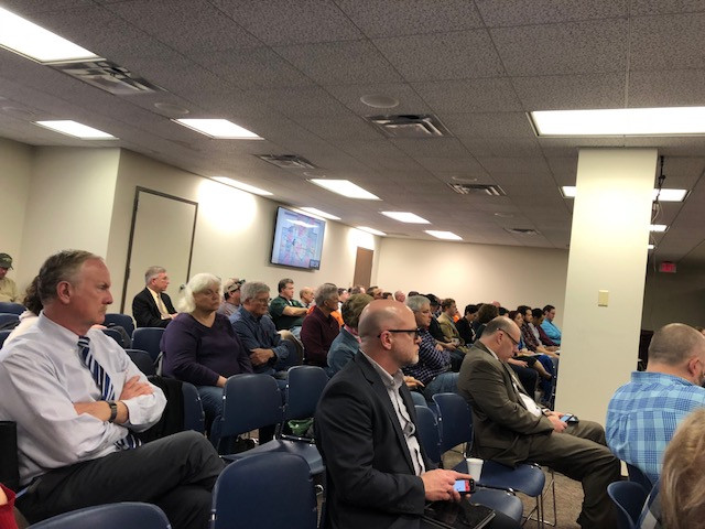 Members of the public listen during Tuesday's McLean County Board meeting in Bloomington / EOCI photo.