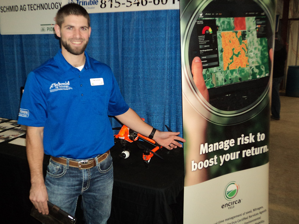 Paul Schmid of Schmid Ag Technology poses by his display at the Gordyville farm show / CIFN photo