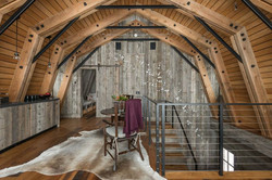 gallery-1485212854-wyoming-barn-inspired-guest-house-kitchen-stairs