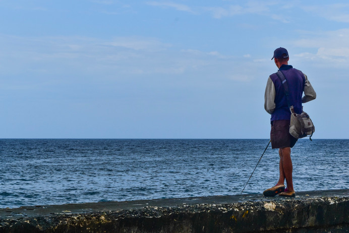 Fishing off the malecon