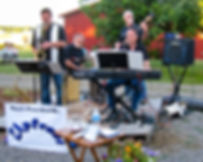 UpFront Band members: Steve Burpee (tenor sax, soprano sax, alto sax, flute), Robert Schultz (drums, percussion, cajon), Chris Bidleman (keyboards, piano), Ed Couture (electric bass, upright bass) performing for wine tasting room and wedding receptions