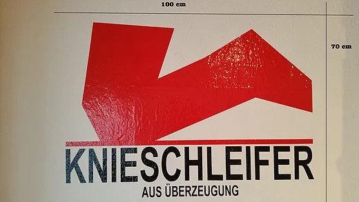 Knieschleifer - Wand-Logo