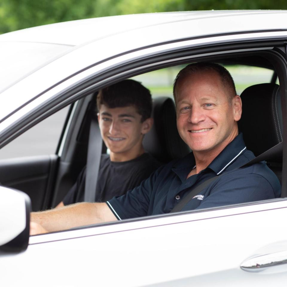 Todd driving with teen student in car