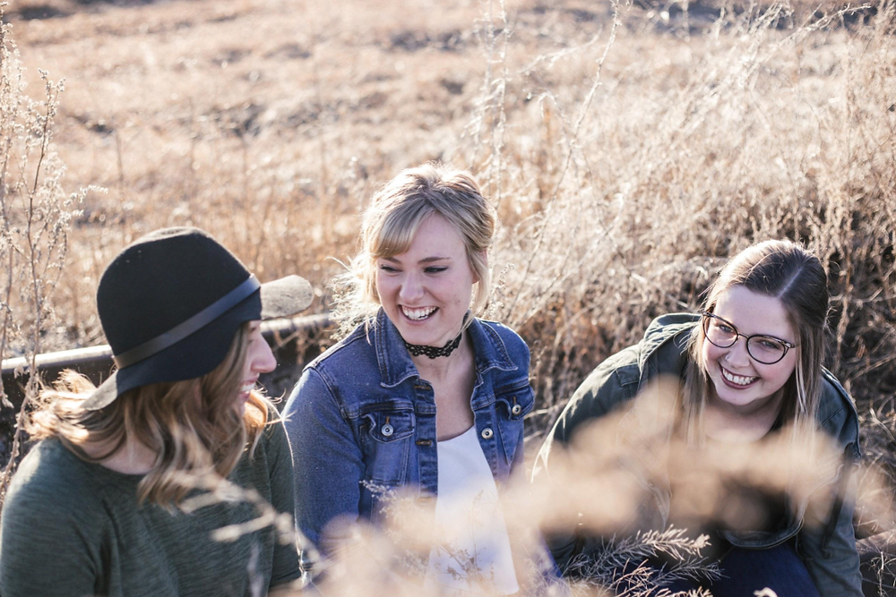 3 teen girls laughing and talking