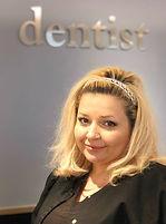 lorna lally dmd, staff member, woman in scrubs, dentist, front desk