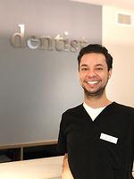 lorna lally dmd, staff member, man in scrubs, dentist, front desk