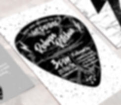 Love Rocks wedding invitation which features a guitar plectrum, black marble, lighting bolts and cool typography. Weddinging stationery perfect for rock music lovers.