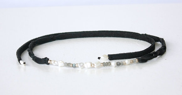 Black leather choker with white pearls