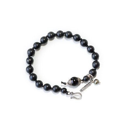 Onyx, Pearl and Silver clasp.