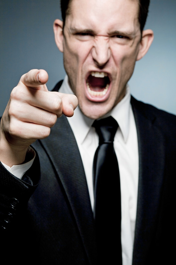 Boss points finger at employee and screa