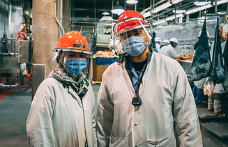GOOD_Workers in PPE gear smiling.jpg