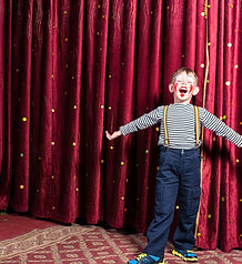Adorable little boy singing on stage dur