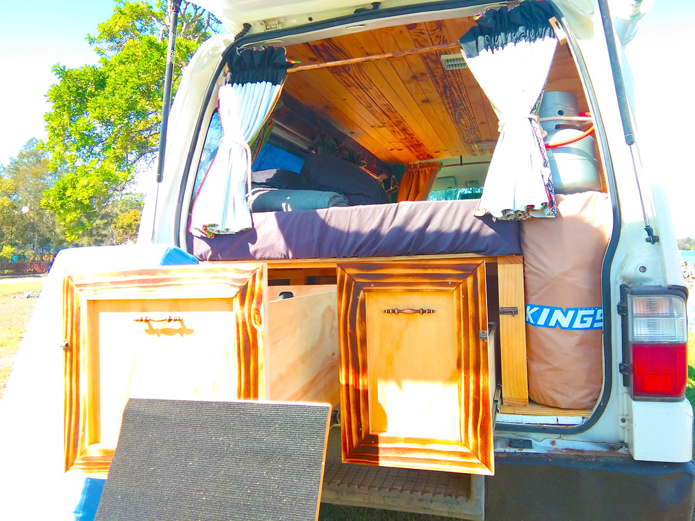 View of the tailgate's shiny timber-interior (dressed pine; some marine ply) we fitted in the Mazda e2000. The darker lining panels were charred with the Japanese wood-burning technique 'Shou Sugi Ban'.