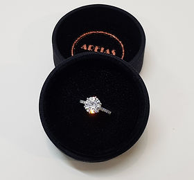 Diamond Solitaire ring with side accent stones