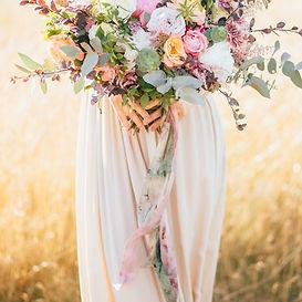big wedding bouquet in hands of the brid