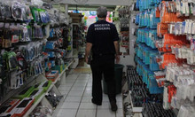 Counterfeit electronic products are seized in store at Carlos Gomes