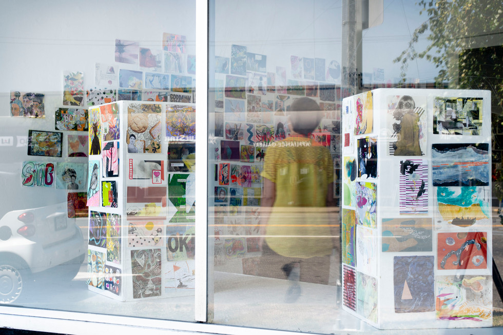 """Postcards from the Pandemic"" window vie"
