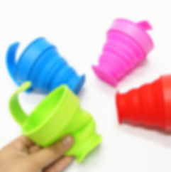 Branded promotional eco-friendly kitchenware products, foldable silicone cups with handles printed with company branding.