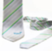 Silver, grey promotional neck ties UK manufacturers with woven company logos, custom-made for corporate uniforms.