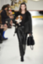 TOD's Runway Models carrying Puppies Black Velocite Shearling Jacket Black Leather Pants